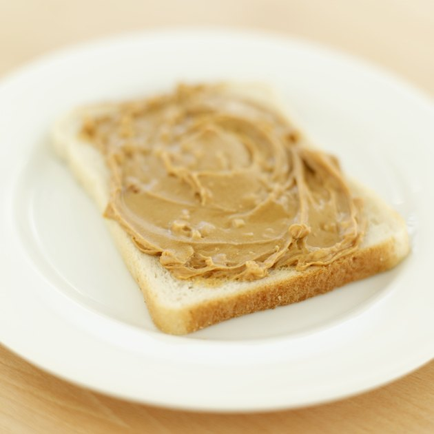 Close-up of peanut butter on a slice of bread
