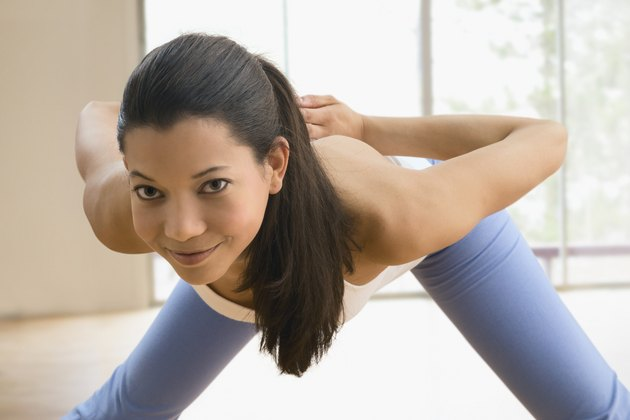 Mixed race woman doing yoga