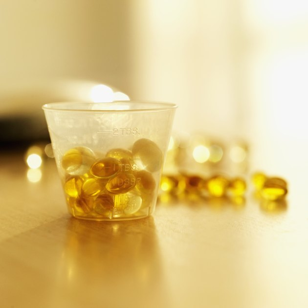 close-up of cod liver oil capsules in a container on a table