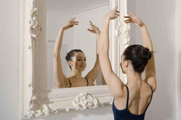 Ballerina posing in mirror