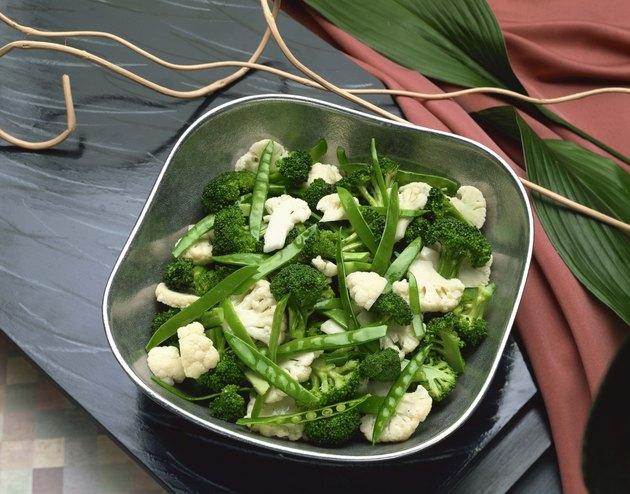Cauliflower , broccoli , and snow peas