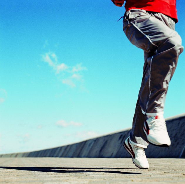 close-up of the legs of a man jogging