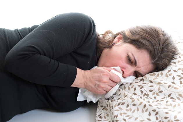 Middle age woman suffering from cold