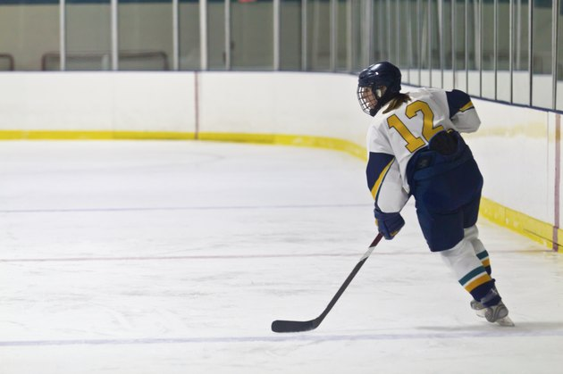Female ice hockey player skating during a game
