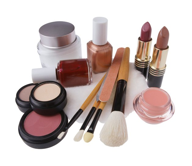 Assorted cosmetics and brushes