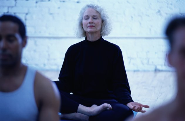 Woman in the Lotus Position in a Yoga Class