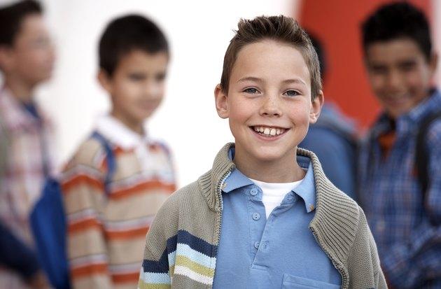Boy (8-10) smiling, portrait, close-up
