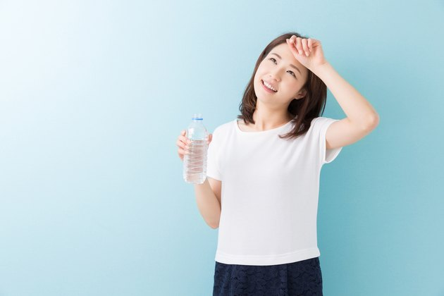 Japanese woman holding water bottle