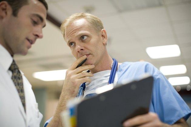 Doctors talking in hospital reception