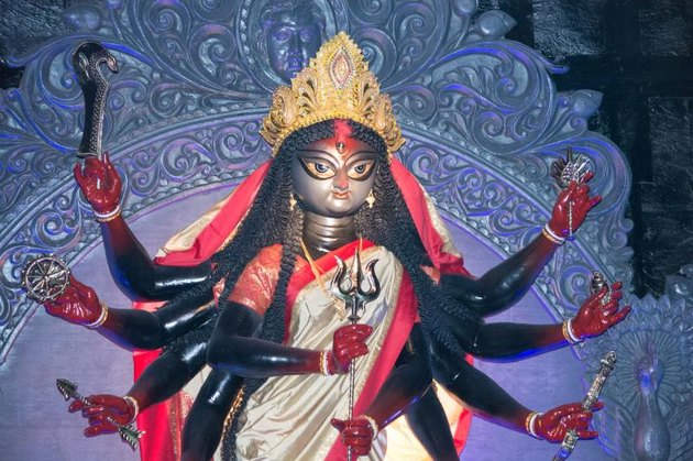 An idol of hindu god kali crafted out of clay shot during a festival in calcutta,india.