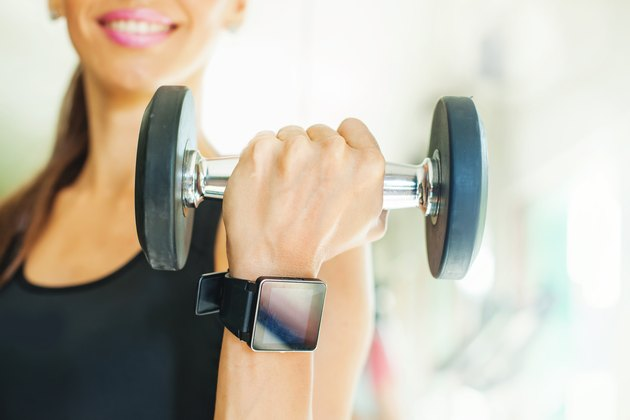 Smart watch on women hand in gym
