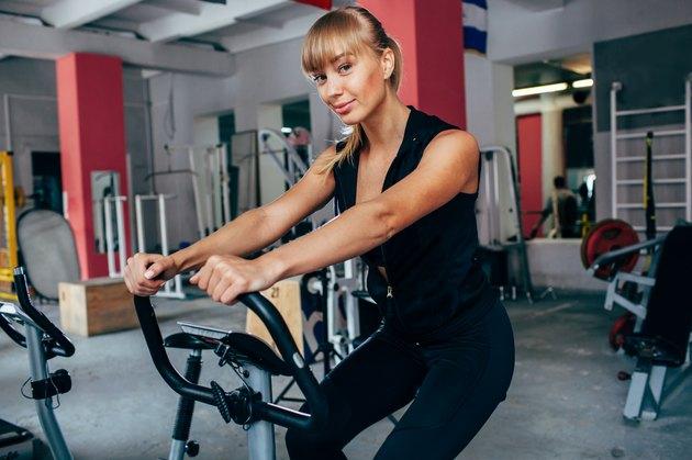 blonde woman on exersizing bike