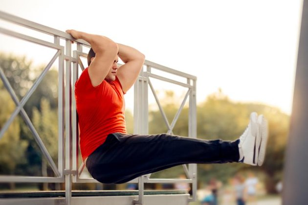 Fitness male model exercising outside