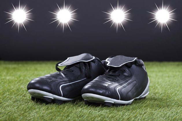 Soccer Shoes Lying On The Green Pitch