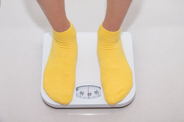 Closeup of a Asians weighed