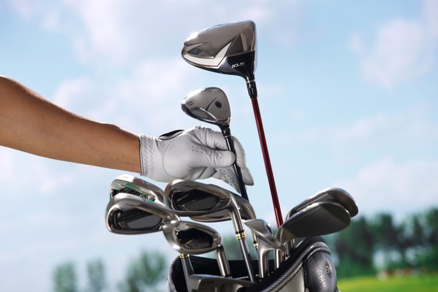 Removing golf club from bag