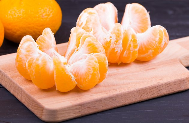 The tangerines peeled on a chopping board