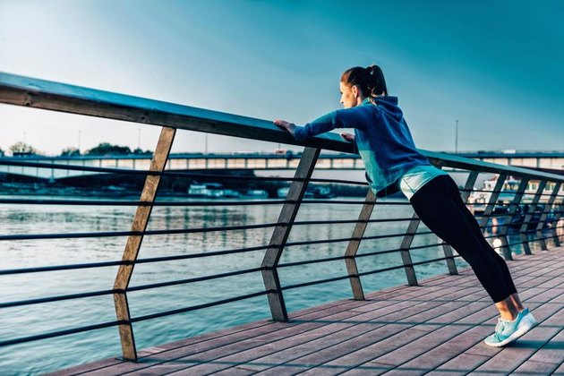 Woman exercising by the river