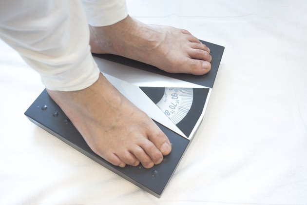 Man standing on weight scales