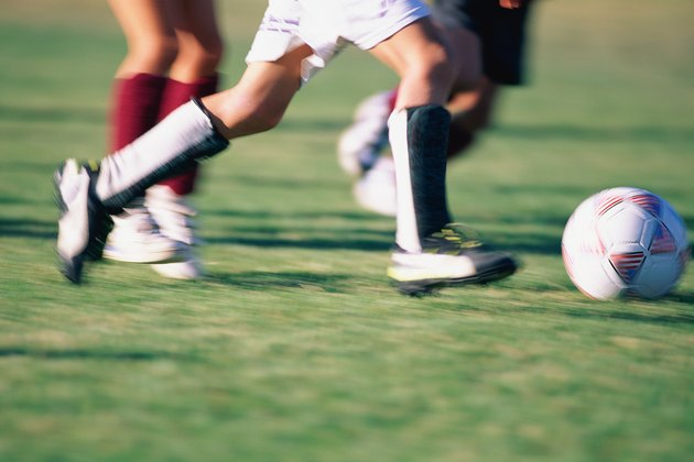 Close-up of soccer players feet and ball