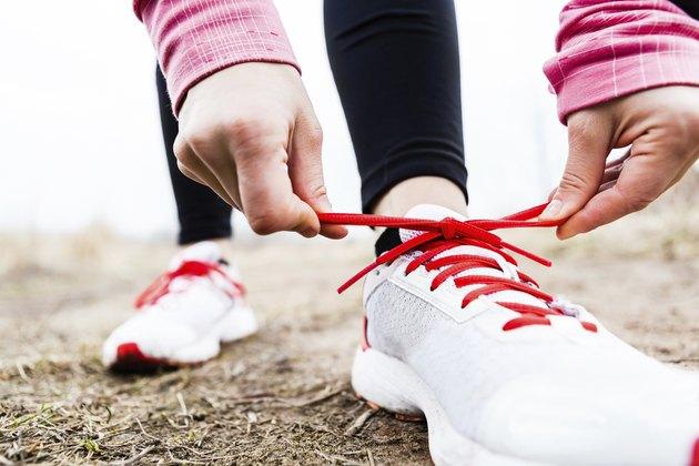 Runner tying sport shoes