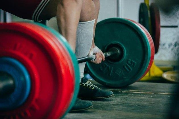 man of powerlifter athlete squat deadlift
