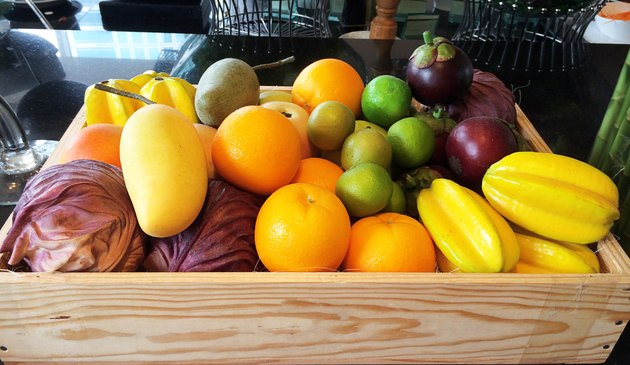 Various types of fruit stored in wooden box