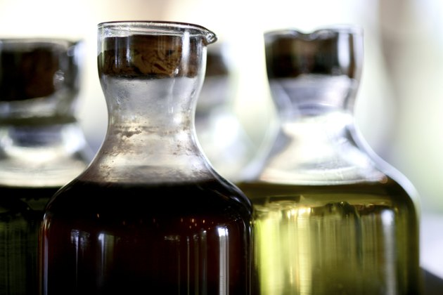 Vinegar and olive oil in a glass bottle