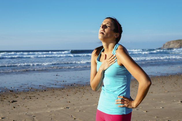 Exhausted female runner suffering angina pectoris