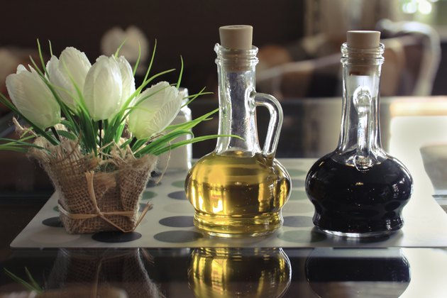 Bottles of olive oil and vinegar on a table