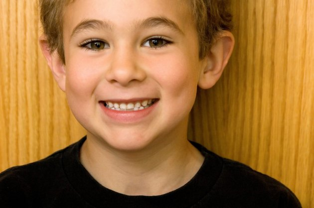 Boy with toothy smile.