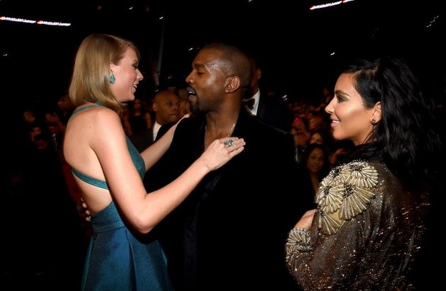 LOS ANGELES, CA - FEBRUARY 08:  (L-R) Recording Artists Taylor Swift, Kanye West and tv personality Kim Kardashian attend The 57th Annual GRAMMY Awards at the STAPLES Center on February 8, 2015 in Los Angeles, California.  (Photo by Larry Busacca/Getty Images for NARAS)