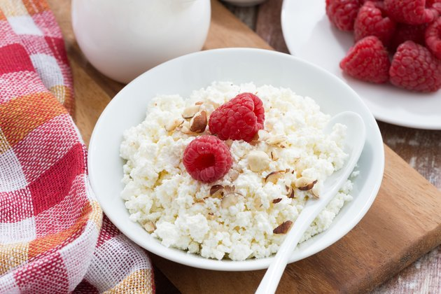 cottage cheese with fresh raspberry, top view