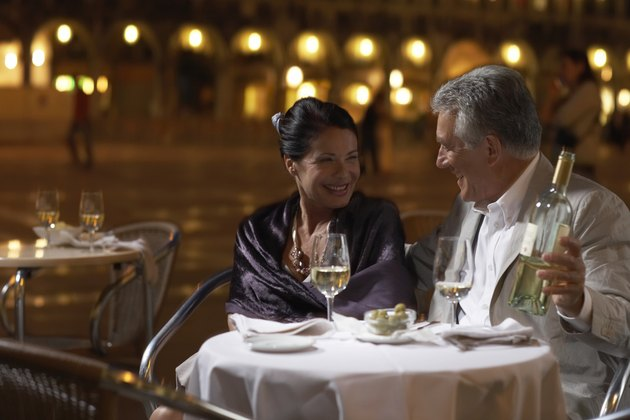 Italy, Venice, couple at restaurant table at night, outdoors
