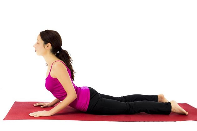 Woman doing Cobra pose for stretching (Series with the same model available)