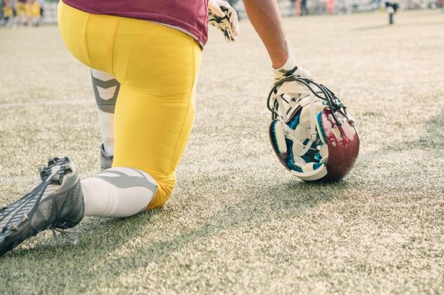 American football player waiting to join the game.