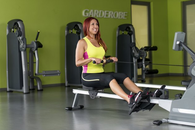 young women on a rowing machine