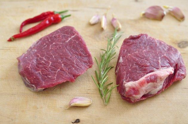 Raw Steak on a chopping board