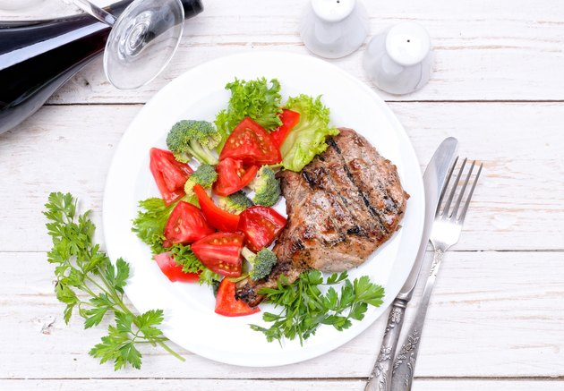 Grilled rib with grilled vegetables.