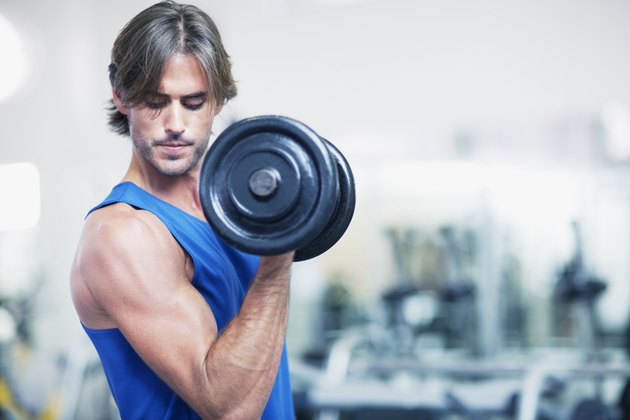 Man holding dumbbell