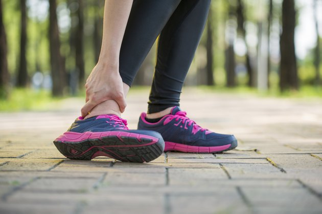 woman runner hold twisted ankle Pain ,Human Leg