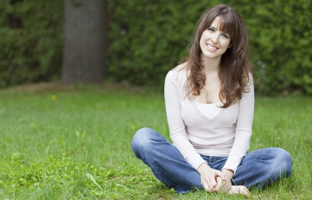 Serene Woman Relaxing At The Park