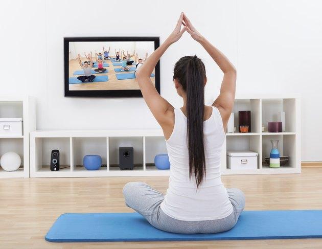 Spiritual woman meditating at home