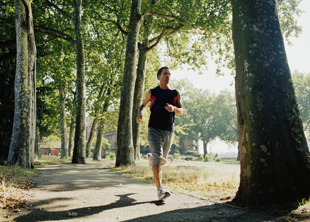 Man running on path in park