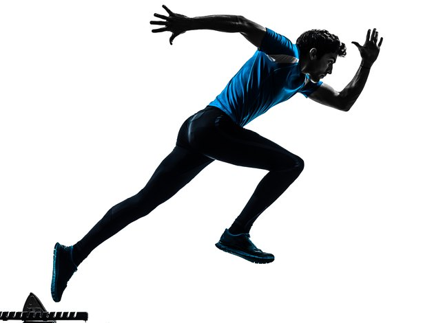 one caucasian man running sprinting jogging in silhouette studio on white background