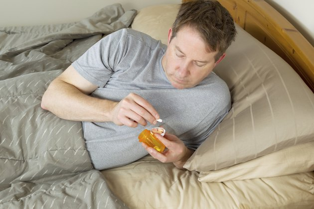 Mature Man looking at his medicine