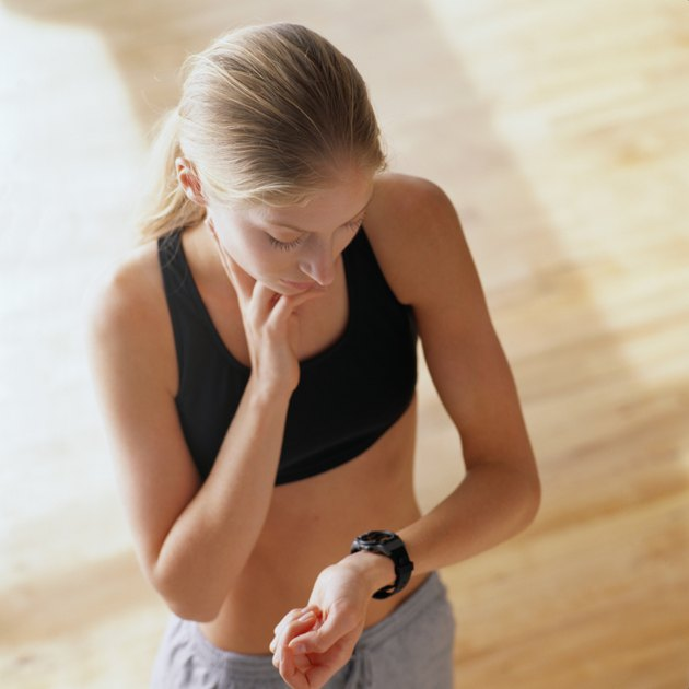 Woman Taking her Pulse After Exercising