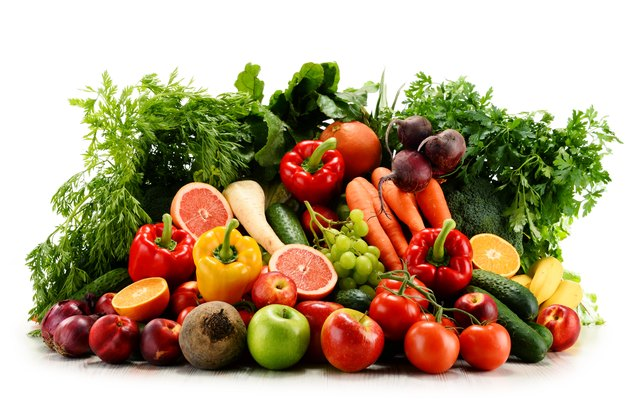 Variety of organic vegetables and fruits isolated on white