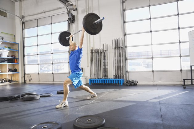 Man practicing Olympic lifts at Crossfit gym