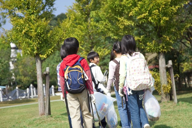 School children carrying bags for recycling
